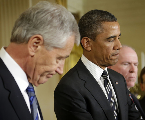 President Barack Obama pauses while speaking in the East Room of the White House in Washington, Monday, Jan. 7, 2013, to announce that he is nominating Deputy National Security Adviser for Homeland Security and Counterterrorism, John Brennan, right, as the new CIA director; and former Nebraska Sen. Chuck Hagel, left, as the new defense secretary.(AP Photo/Pablo Martinez Monsivais)
