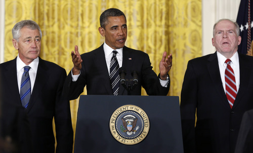 President Barack Obama gestures as he speaks in the East Room of the White House in Washington, Monday, Jan. 7, 2013, to announce that he is nominating Deputy National Security Adviser for Homeland Security and Counterterrorism, John Brennan, right, as the new CIA director; and former Nebraska Sen. Chuck Hagel, left, as the new defense secretary. (AP Photo/Carolyn Kaster)