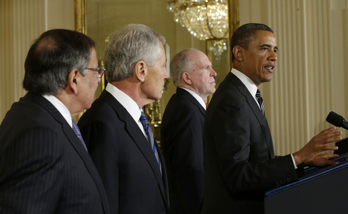 President Barack Obama speaks in the East Room of the White House in Washington, Monday, Jan. 7, 2013, to announce that he is nominating Deputy National Security Adviser for Homeland Security and Counterterrorism, John Brennan, second from the right, as the new CIA director; and former Nebraska Sen. Chuck Hagel, second from the left, as the new Defense Secretary, to replace outgoing Defense Secretary Leon Panetta, far left. (AP Photo/Pablo Martinez Monsivais)