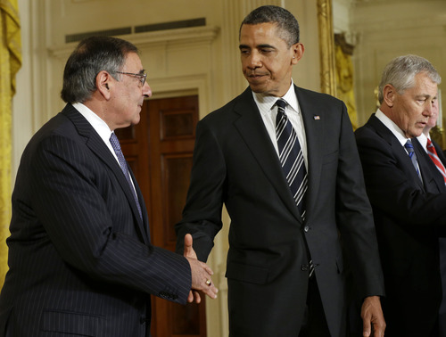 President Barack Obama shakes hands with outgoing Defense Secretary Leon Panetta in the East Room of the White House, Monday in Washington, Jan. 7, 2013, where he announced that he is nominating former Nebraska Sen. Chuck Hagel, right,  to succeed Panetta.  (AP Photo/Pablo Martinez Monsivais)