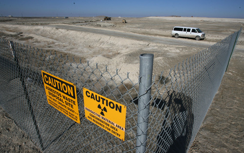 Steve Griffin | The Salt Lake Tribune   Fencing, with caution signs, surround the EnergySolutions low level radioactive waste facility in Clive, Utah, about 80 miles from Salt Lake City. The company announced Monday that it is being sold to a private equity firm.