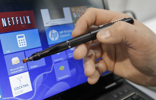 E Fun's Apen Touch8 pen is shown at the International Consumer Electronics Show in Las Vegas, Tuesday, Jan. 8, 2013. Many people who have tried Microsoft's new Windows 8 operating system without a touch screen have hated it because of the inability to use touch and swipe commands to get things going. Now a company has made a digital pen to allow people to use Windows 8 on their old monitors for less than the cost of buying a new touch-enabled computer. (AP Photo/Jae C. Hong)