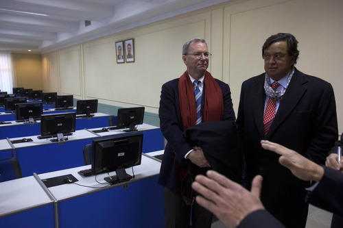 Executive Chairman of Google, Eric Schmidt, left, and former New Mexico governor Bill Richardson tour a computer lab at Kim Il Sung University in Pyongyang, North Korea on Tuesday, Jan. 8, 2013. Schmidt is the highest-profile U.S. executive to visit North Korea-a country with notoriously restrictive online policies-since young leader Kim Jong Un took power a year ago. (AP Photo/David Guttenfelder)