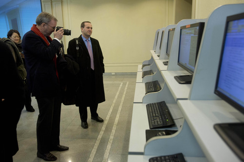 Executive Chairman of Google, Eric Schmidt, takes photographs as he tours a computer lab at Kim Il Sung University in Pyongyang, North Korea on Tuesday, Jan. 8, 2013. Schmidt is the highest-profile U.S. executive to visit North Korea - a country with notoriously restrictive online policies-since young leader Kim Jong Un took power a year ago. (AP Photo/David Guttenfelder)