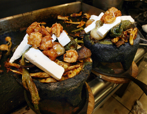 Steve Griffin  |  The Salt Lake Tribune The Molcajete dinner at Rancho Market, served in a lava-rock bowl, is large enough to feed two people.