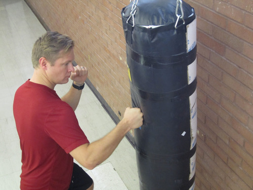 University of Utah medical student Michael Morgan strikes a punching bag used by Morgan and professor David Carrier in a study that suggests human hands evolved for fighting with fists. Photo by Lee J. Siegel, courtesy of the U.