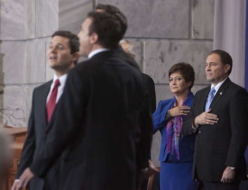 Steve Griffin | The Salt Lake Tribune  Utah Gov. Gary Herbert and first lady Jeanette Herbert hold their hands over their hearts as the listen their sons Bradley, Daniel and Nathan Herbert sing the national anthem during inauguration ceremony for Herbert as Utah's 17th governor at the Utah State Capitol in Salt Lake City, Utah Monday January 7, 2013.