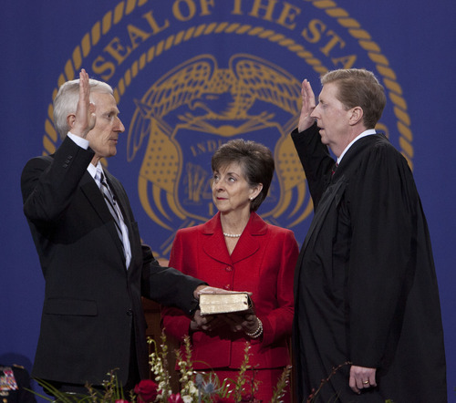 Steve Griffin | The Salt Lake Tribune   JoLynn Bell holds the Bible for her husband, Utah Lt. Gov. Greg Bell,  as he is sworn in by Chief Justice Matthew B. Durrant at the Utah State Capitol  in Salt Lake City, Utah Monday January 7, 2013.