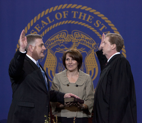 Steve Griffin | The Salt Lake Tribune   Joyce Ellis holds the Bible for her husband, Utah Treasurer Richard Ellis, as he is sworn in by Chief Justice Matthew B. Durrant at the Utah State Capitol in Salt Lake City, Utah Monday January 7, 2013.