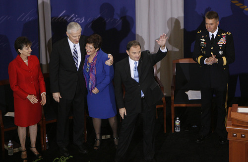 Francisco Kjolseth  |  The Salt Lake Tribune Gov. Gary Herbert waves to those gathered at the Utah State Capitol on Monday, January 7, 2013, for his inauguration ceremony as the 17th Utah Governor. Also pictured are Lieutenant Governor Greg Bell and his wife JoLynn, left, along with Jeanette Herbert and master of ceremonies Major General Jefferson S. Burton.