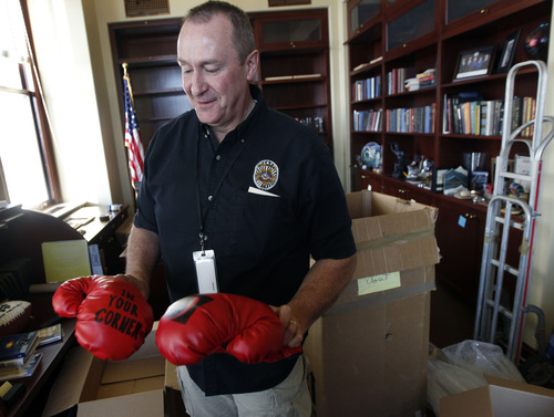 Al Hartmann  |  The Salt Lake Tribune Mark Shurtleff reminisces over his 12-year career as Utah attorney general as a moving crew packs up his office Thursday. He remembers the boxing gloves given to him when he was trying to beat cancer several years ago.  His stint as the state's top prosecutor ends Monday.