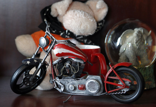 Al Hartmann  |  The Salt Lake Tribune A model of a motorcycle sits on a shelf in the office of Utah Attoney General Mark Shurtleff. He severely injured his leg in a motorcycle accident several years ago and underwent many surgeries to repair it.  He said that he doesn't own a motorcycle now but will ride again someday. It was among items packed up by a moving crew Thursday as Shurtleff's 12-years in the office come to an end.