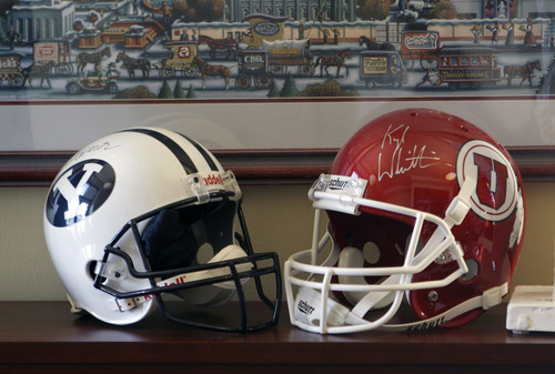 Al Hartmann  |  The Salt Lake Tribune A BYU and University of Utah football helmet sit on a shelf in the office of Utah Attoney General Mark Shurtleff. He attended both schools and claims to be equally loyal to each.  They were among items packed up by a moving crew Thursday as Shurleff prepared to leave office.