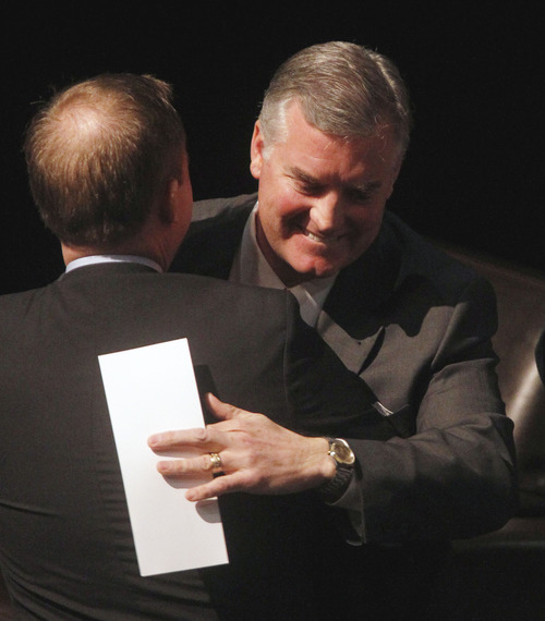 Al Hartmann  |  The Salt Lake Tribune Outgoing Salt Lake County Mayor Peter Corroon, right,  gives a hug to his replacement, incoming Mayor Ben McAdams, after taking the oath of office at the Rose Wagner Theatre Monday January 7.