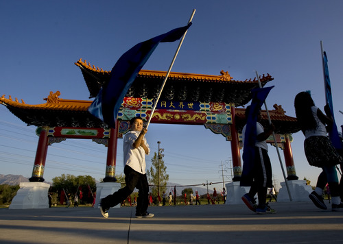 Kim Raff | The Salt Lake Tribune Children from five different area schools who are part of the Chinese emersion program march around the Chinese Heritage Gate during an unveiling at the Utah Cultural Center in West Valley City on Sept. 29, 2012. The gate, which is symbol of friendship between West Valley City and Nantou, Taiwan has come under scrutiny with some members of the Asian community who are upset about how the money has been handled.