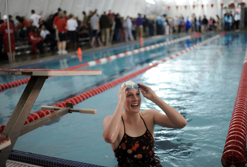 Olympic gold medalist Missy Franklin, of Regis Jesuit, smiles while standing in the pool during Regis Jesuit's swim meet against Highlands Ranch on Tuesday, Jan. 8, 2013, in Aurora, Colo. (AP Photo/The Denver Post, Hyoung Chang)