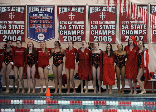 Olympic gold medalist Missy Franklin, second from right, and her Regis Jesuit teammates gather during a swimming meet against Highlands Ranch at the Regis Jesuit swimming pool on Tuesday, Jan. 8, 2013, in Aurora, Colo. (AP Photo/The Denver Post, Hyoung Chang)