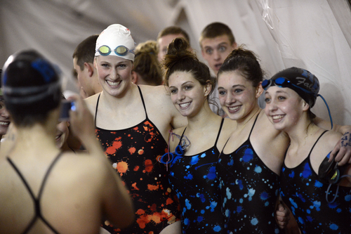 Olympic gold medalist and Regis Jesuit swimmer Missy Franklin, second from left, poses for a picture with Highlands Ranch swimmers after a meet at the Regis Jesuit swimming pool on Tuesday, Jan. 8, 2013, in. Aurora. Colo. (AP Photo/The Denver Post, Hyoung Chang)