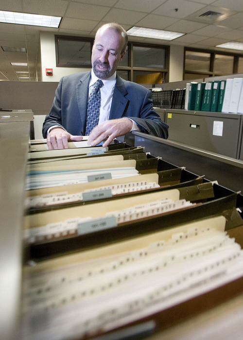 Paul Fraughton  |  The Salt Lake Tribune Assistant Attorney General David Wolf goes through one of several filing cabinets dealing with the United Effort Plan (UEP) Trust.  Tuesday, December 18, 2012