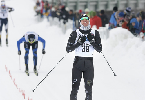 Scott Sommerdorf   |  The Salt Lake Tribune Torin Koos, #39, reacts as he crosses the finish line to win the Senior Men's U.S. Championship 30k at Soldier Hollow, Sunday, January 6, 2013. Erik Bjornsen was second with David Norris third.