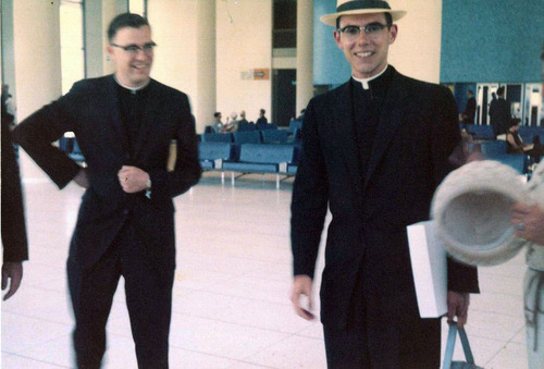 Courtesy photo Geroge H. Niederauer, left, and William Levada are seen together in this photo from 1962 at Los Angeles International Airport shortly after Levada returned from a trip to Rome. The men first met in a  Los Angeles high school, studied at the same seminary, and now as retirees will share a condo in Long Beach, Calif.