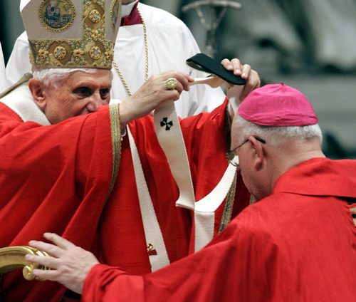 Pope Benedict XVI bestows the pallium, or a woolen shawl, on George Hugh Niederauer, Arhbishop of San Francisco, CA, during a mass inside St. Peter's Basilica at the Vatican on June 29, 2006. The Pope bestowed the pallium on 27 metropolitan archbishops from around the world that day to symbolize their bond with the Vatican. (AP Photo/Pier Paolo Cito)