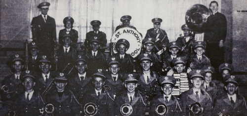 "courtesy Retirees Archbishop of San Francisco George Niederauer (bottom row second in from the right) and Cardinal Bill Levada (third row from bottom third in from the left) in their high School band at St. Anthony's Catholic School. They were conscripted into the school band, Niederauer says, where he was a ""lousy"" trombone player, while Levada had more talent on the clarinet."