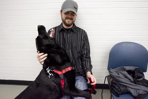 Kim Raff     The Salt Lake Tribune Austin Cochran, an Air Force veteran, pets Grizz during Canines With A Cause class at Northwest Recreation Center in Salt Lake City on December 21, 2012. Canines With A Cause is a non-profit that trains veterans and their dogs.
