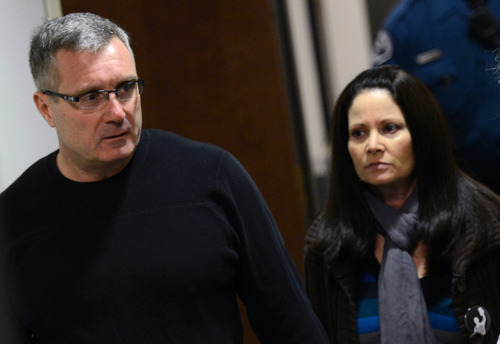 Thomas Teves, left, and his wife Caren Teves arrive for court, Tuesday, Jan. 8, 2012, on the second day of hearings for accused Aurora theater gunman James Holmes, in Centenneial, Colo. The couple's 24-year-old son Alex was killed in the attack. (AP Photo/The Denver Post, RJ Sangosti)