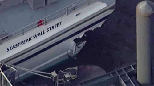 This aerial photo provided by WABC News Channel 7 shows damage to a commuter ferry in Lower Manhattan, Wednesday, Jan. 9, 2013, in New York. The Fire Department says about 17 people were injured when the ferry from New Jersey struck a dock during rush hour. (AP Photo/WABC News Channel 7)
