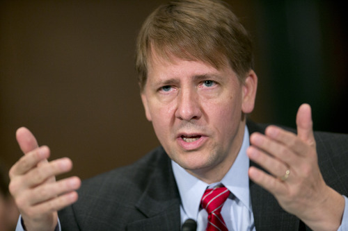 Richard Cordray, director of the Consumer Financial Protection Bureau (CFPB), testifies during a Senate Banking Committee hearing in Washington, D.C., U.S., on Thursday, Sept. 13, 2012. Through regulatory tools, the CFPB has proposed smarter rules that will help fix the broken mortgage market with common-sense solutions, and writing rules that simplify mortgage disclosure forms, Cordray said. Photographer: Andrew Harrer/Bloomberg *** Local Caption *** Richard Cordray