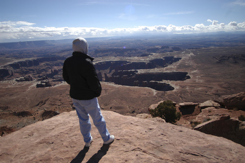 Tom Wharton   Tribune file photo  A lone hiker stands on an overlook at Island in the Sky's Grand View Point inside Canyonlands National Park.