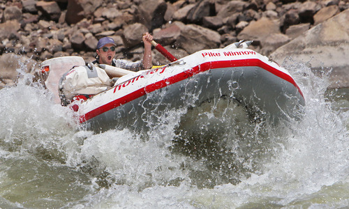 Francisco Kjolseth     The Salt Lake Tribune Visitors come from across the world to take a whitewater river trip down the Colorado and Green rivers in Canyonlands National Park. This Holiday River Expeditions raft with Justin Malloy floated the Colorado River in the summer of 2012.