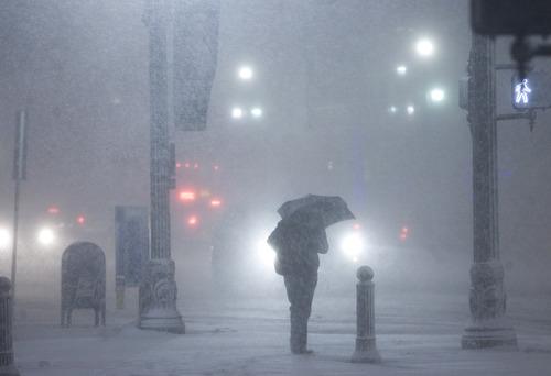 Kim Raff | The Salt Lake Tribune walk through heavy snow on Main Street during the evening commute in downtown Salt Lake City on January 10, 2013.