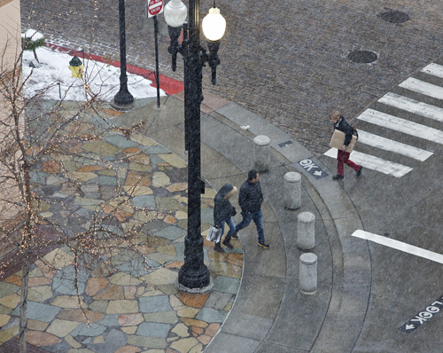 Lennie Mahler  |  The Salt Lake Tribune Pedestrians walk through The Gateway Mall as a snowstorm blows in Thursday, Jan. 10, 2013.
