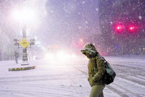 Kim Raff | The Salt Lake Tribune A pedestrian walks through heavy snow on Main Street during the evening commute in downtown Salt Lake City on January 10, 2013.