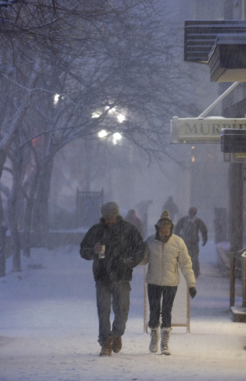 Kim Raff | The Salt Lake Tribune Pedestrians walks through heavy snow on Main Street during the evening commute in downtown Salt Lake City on January 10, 2013.