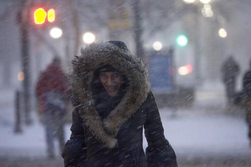 Kim Raff | The Salt Lake Tribune Monique Jones walks through heavy snow on Main Street during the evening commute in downtown Salt Lake City on January 10, 2013.