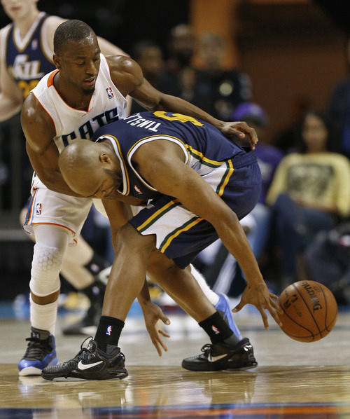 Utah Jazz's Jamaal Tinsley, right, loses the ball as Charlotte Bobcats' Kemba Walker, left, defends during the first half of an NBA basketball game in Charlotte, N.C., Wednesday, Jan. 9, 2013. (AP Photo/Chuck Burton)