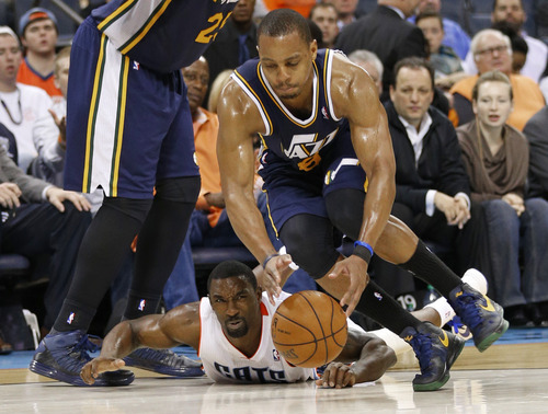 Utah Jazz's Randy Foye, front, steals the ball from Charlotte Bobcats' Ben Gordon, back, during the second half of an NBA basketball game in Charlotte, N.C., Wednesday, Jan. 9, 2013. The Jazz won 112-102. (AP Photo/Chuck Burton)
