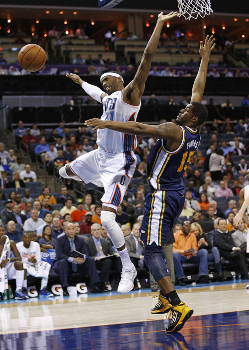 Charlotte Bobcats' Hakim Warrick (21) loses the ball as Utah Jazz's Derrick Favors (15) defends during the second half of an NBA basketball game in Charlotte, N.C., Wednesday, Jan. 9, 2013. The Jazz won 112-102. (AP Photo/Chuck Burton)