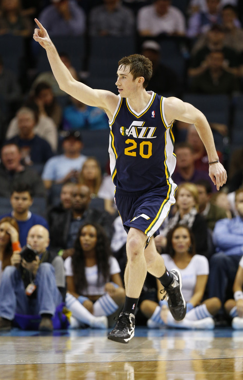 Utah Jazz's Gordon Hayward (20) reacts after making a three-point shot against the Charlotte Bobcats during the second half of an NBA basketball game in Charlotte, N.C., Wednesday, Jan. 9, 2013. The Jazz won 112-102. (AP Photo/Chuck Burton)