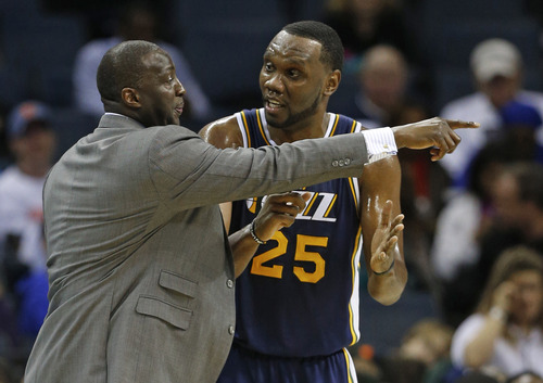 Utah Jazz's Tyrone Corbin, left, talks with Al Jefferson, right, during the first half of an NBA basketball game against the Charlotte Bobcats in Charlotte, N.C., Wednesday, Jan. 9, 2013. (AP Photo/Chuck Burton)