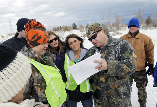 Al Hartmann  |  The Salt Lake Tribune Team leader Coy Barnson, right, organizes volunteers near 12800 South 4400 West to search for missing Herriman teen Brooklyn Gittins. Many groups of this size were sent to search the Herriman area Thursday.