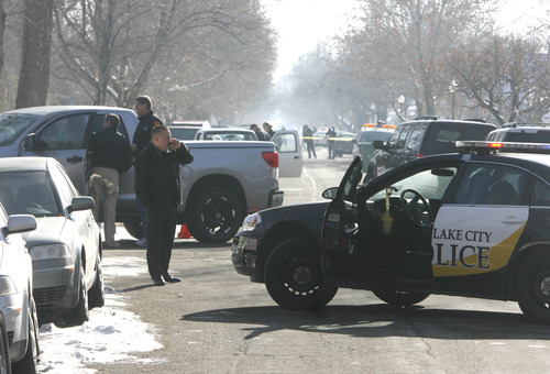 Rick Egan    The Salt Lake Tribune   Police officers Investigate the scene of a shooting on Lake Street, between 800 and 900 south in Salt Lake, Wednesday, January 9, 2013.