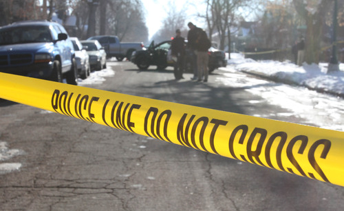 Rick Egan  | The Salt Lake Tribune   Police officers Investigate the scene of a shooting on Lake Street, between 800 and 900 south in Salt Lake, Wednesday, January 9, 2013.