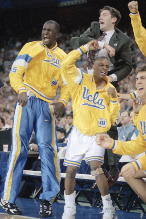 UCLAs Tyus Edney, foreground, and other teammates celebrate on the bench as UCLA takes the lead in the second-half of the NCAA Championship game at the Seattle Kingdome, Monday, April 3, 1995, Seattle, Wash. Edney, whose start was in doubt, left the game shortly after play began because of an injured right wrist. (AP Photo/Eric Draper)