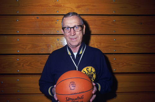 A January 1990 photo of UCLA Basketball coach John Wooden, in Los Angeles. (AP Photo/hf)