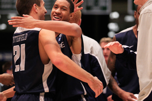 Utah State's Marcel Davis is congratulated by his teammate Spencer Butterfield, left, after scoring a basket during the NCAA basketball game between Utah Valley University and Utah State in Orem on Saturday, Dec. 15, 2012. SPENSER HEAPS/Daily Herald