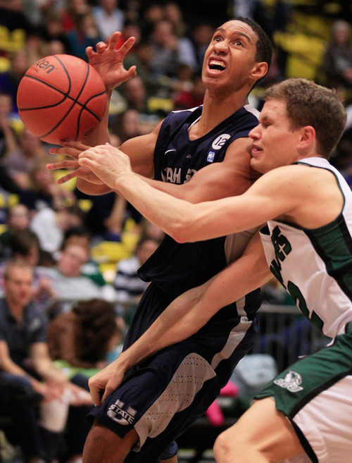 Utah State's Marcel Davis collides with UVU's Holton Hunsaker during the NCAA basketball game between Utah Valley University and Utah State in Orem on Saturday, Dec. 15, 2012. SPENSER HEAPS/Daily Herald